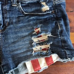 Harper Shorts - Distressed jean shorts with American flag pockets